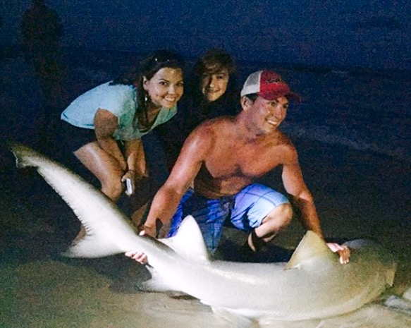 A lemon shark. Kristin, Jake's girlfriend and fishing mate is on the left.